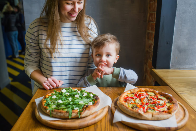 Mom and autistic son make homemade pizza